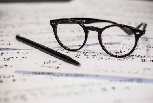 dayne topkin glasses, pen and paper